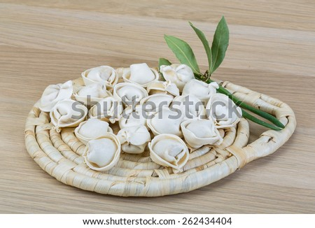 Raw Russian dumplings with meat - ready for cooking - stock photo