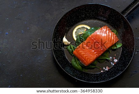 Raw salmon fillet in frying pan - stock photo