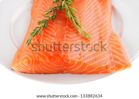 raw salmon fillet isolated on white with rosemary