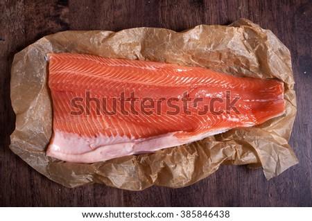 Raw salmon fillet on kitchen paper - stock photo
