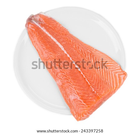 Raw salmon fillet on plate. Top view. Isolated on a white background. - stock photo