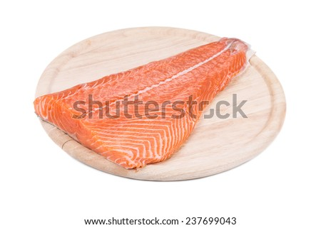 Raw salmon fillet on wood platter. Isolated on a white background.