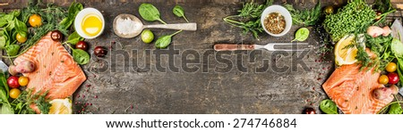 Raw salmon fillet with cooking ingredients: oil, fresh seasoning, spoon and fork on rustic wooden background, top view, banner for website. - stock photo