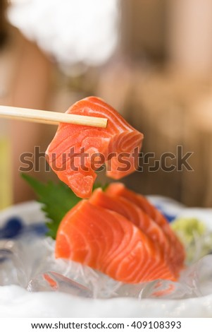 Raw Salmon in the chopsticks