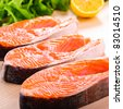 Raw salmon steak in row, prepared for cooking - stock photo