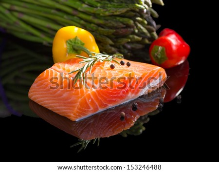 Raw salmon steak isolated on black background with reflection. - stock photo