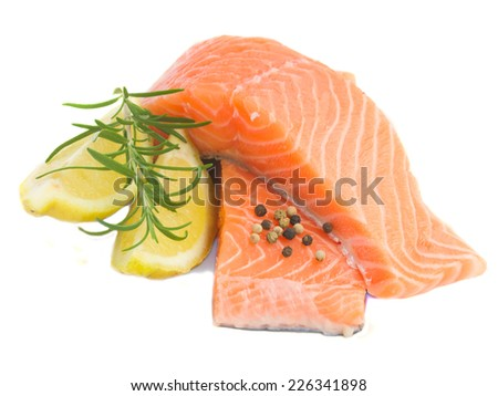 raw salmon steaks with rosemary and spices isolated on white background - stock photo