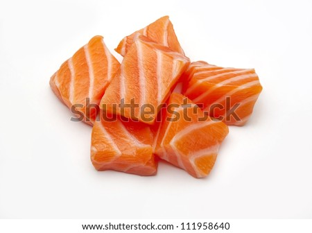 Raw salmon sushi meat cubes photographed on a white background. - stock photo