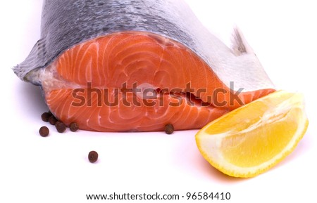 Raw salmon with lemon and pepper isolated on white