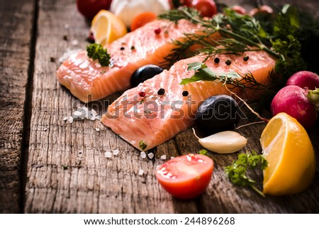 Raw salmons fillets on wooden background,selective focus  - stock photo