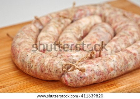Raw sausage for frying. Ukrainian food. Polish cuisine. Homemade raw food. - stock photo