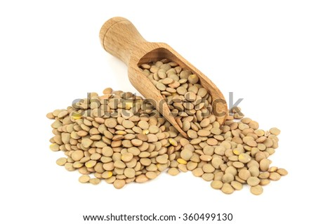 raw scattered lentils on white background