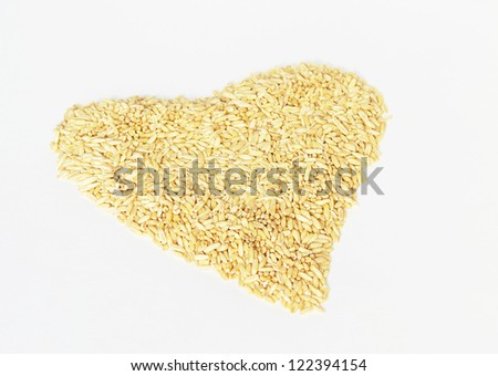 Raw seeds background in a heart shape - stock photo