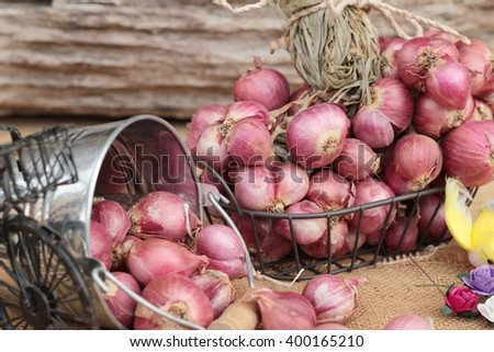 raw shallots for cooking on wood background.