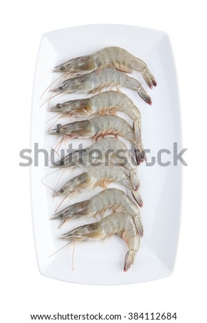 Raw Shrimps on white plate - stock photo