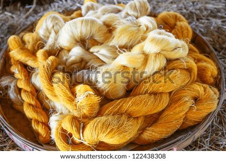 Raw silk thread - stock photo