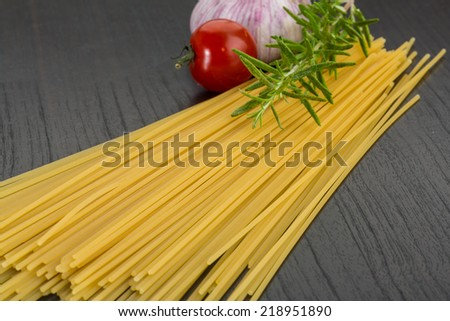 Raw spagetti with rosemary and garlic - stock photo