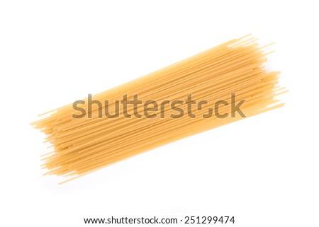 Raw spaghetti isolated on a white background - stock photo