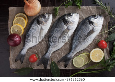 Raw Sparus Aurata or gilt-head bream fish readey for cooking - stock photo