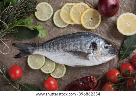 Raw Sparus Aurata or gilt-head bream fish ready for cooking - stock photo