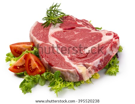 Raw steak and vegetables - stock photo