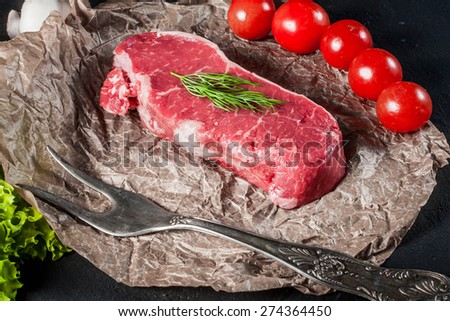 Raw steak with tomatoes, mushrooms and dill. - stock photo