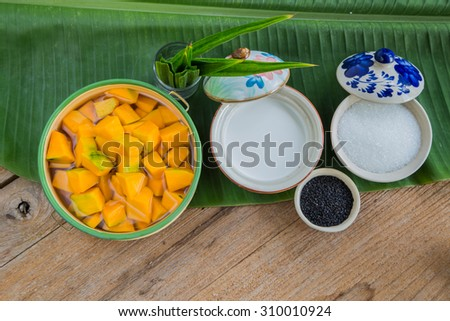 Raw Thailand dessert, pumpkin in coconut milk on the wooden background