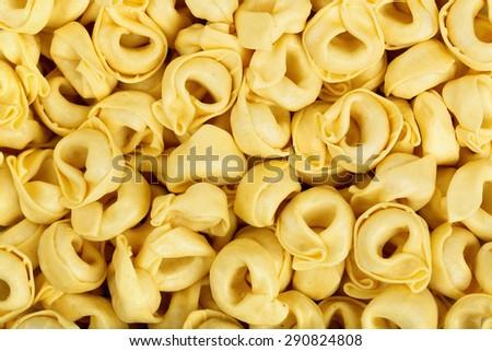 raw tortellini pasta closeup for background use - stock photo
