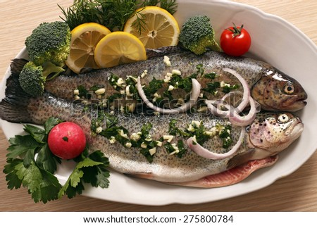 raw trout fish with salad - stock photo