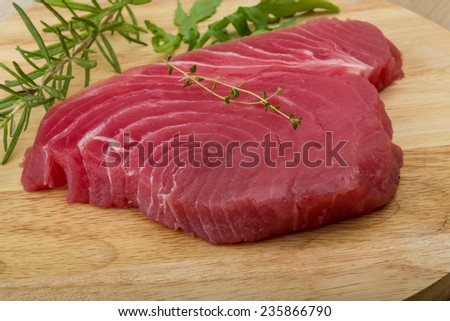 Raw tuna steak with rosemary and thyme