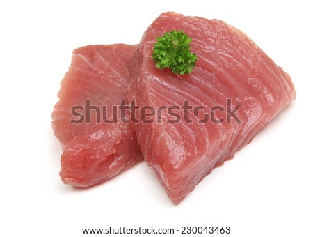 Raw tuna steaks on white background.