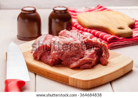 Raw turkey in pieces on a bamboo board. - stock photo