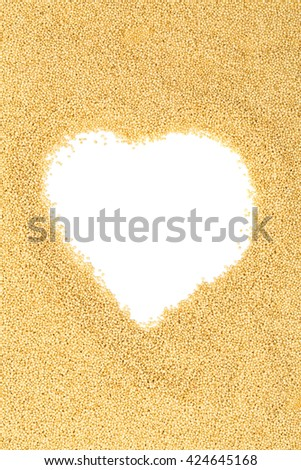 Raw, uncooked amaranth seeds heap heart shaped on white background with copy space - stock photo