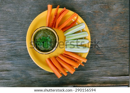 raw vegan mushroom pasty with parsley and fresh vegetables on wooden table - stock photo