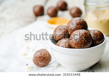 Raw vegan peanut butter oat coconut cacao balls. the toning. selective focus - stock photo