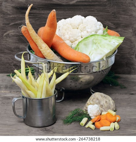 raw vegetables for soup on wooden table - stock photo