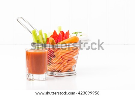 Raw vegetables in a fryer basket suggesting an alternative to fast food. - stock photo