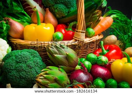 Raw vegetables in wicker basket - stock photo