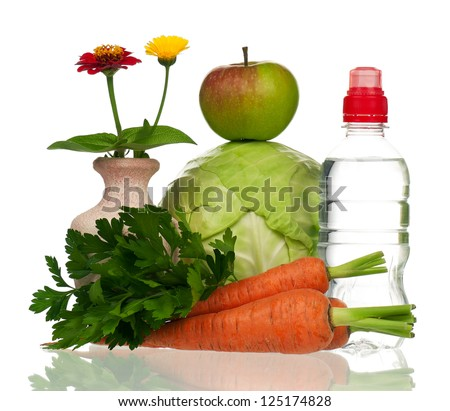 Raw vegetables with bottle of water isolated on white background - stock photo