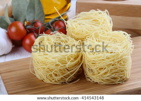 Raw vermicelli on the wood background ready for cooking