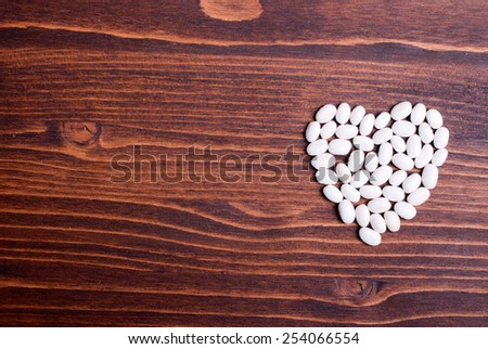 raw white beans on  board dietetic food - stock photo