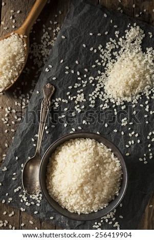 Raw White Sushi Rice in a Bowl - stock photo