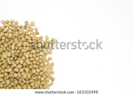 Raw wholegrain soybean in round shape, isolated - stock photo