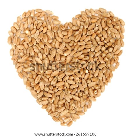 Raw wholegrain wheat in heart shape, isolated - stock photo