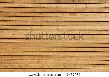 Raw wood, wooden slatted fence or wall - stock photo