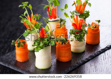 Raw Zucchini and Carrot Roll-Ups for holiday - stock photo