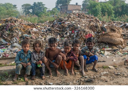 RAXAUL, INDIA - NOV 8: Unidentified Indian children on Nov 8, 2013 in Raxaul, Bihar state, India. Bihar is one of the poorest states in India. The per capita income is about 300 dollars. - stock photo