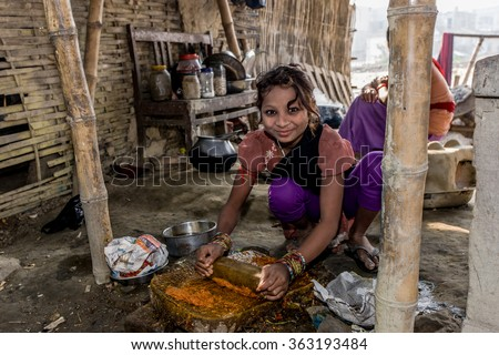 RAXAUL, INDIA - NOV 12: Unidentified Indian girl on Nov 12, 2013 in Raxaul, Bihar state, India. Bihar is one of the poorest states in India. The per capita income is about 300 dollars. - stock photo