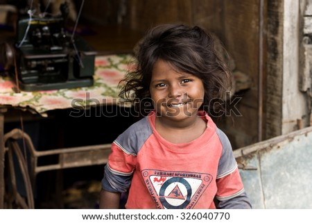 RAXAUL, INDIA - NOV 7: Unidentified Indian girl on Nov t, 2013 in Raxaul, Bihar state, India. Bihar is one of the poorest states in India. The per capita income is about 300 dollars. - stock photo