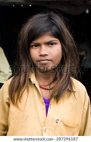 RAXAUL, INDIA - NOV 7: Unidentified Indian girl poses for a portrait on Nov 7, 2013 in Raxaul, Bihar state, India. Bihar is one of the poorest states in India. The per capita income is about 300 dollars.